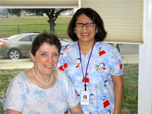 Woman with home health care therapist.